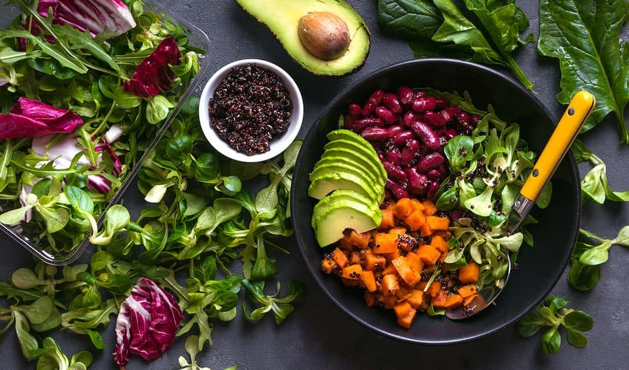 Quinoa salad in bowl with avocado sweet potato