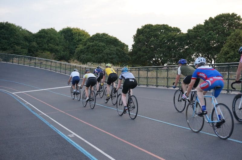 teenagers cycling in a velodrome