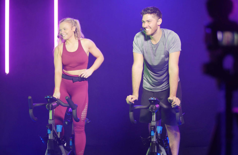 boy and girl on exercise bikes